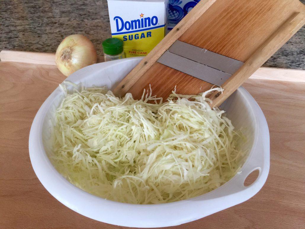 Cutting cabbage German Coleslaw Recipe