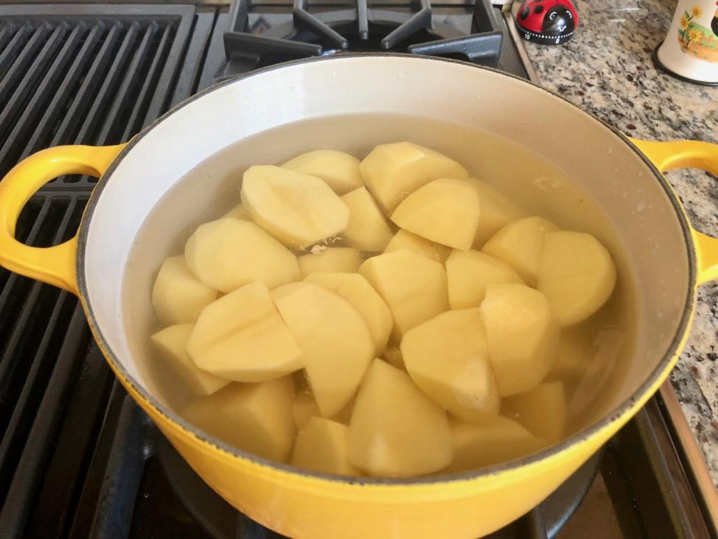 Boiling potatoes for Traditional Dauphine Potatoes