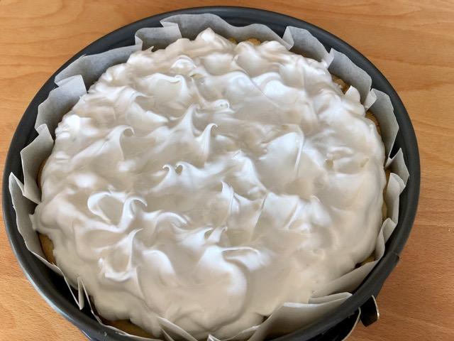 Spreading the meringue onto the Homemade Rhubarb Cake