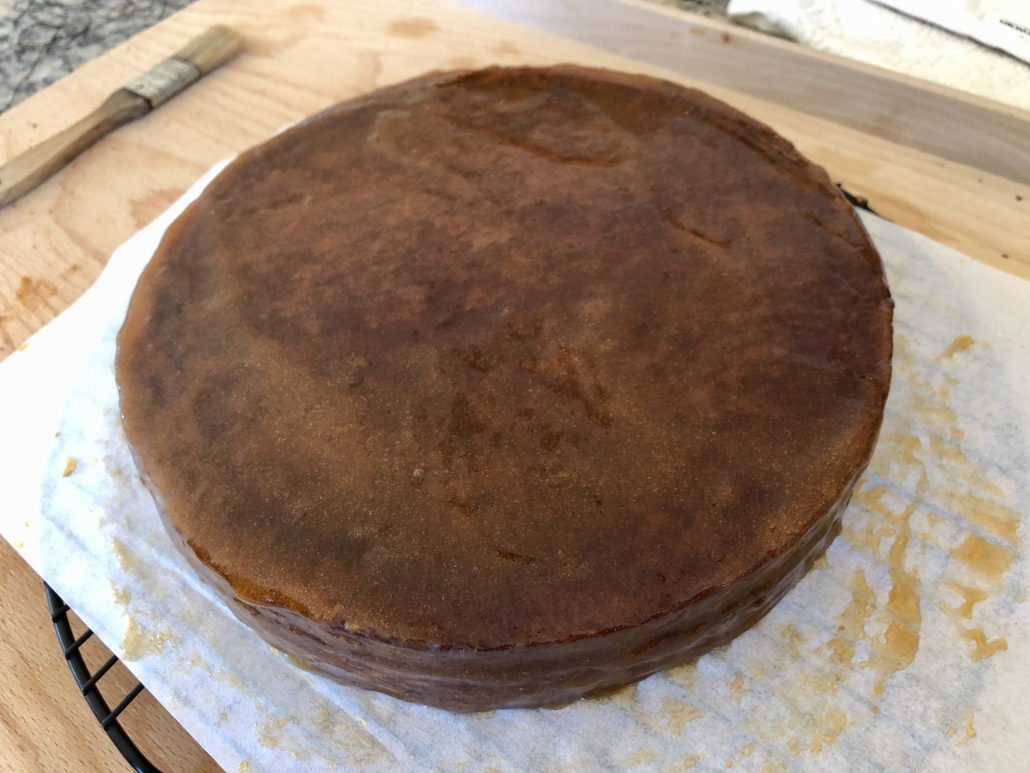 applying the apricot jam onto the Sacher Torte