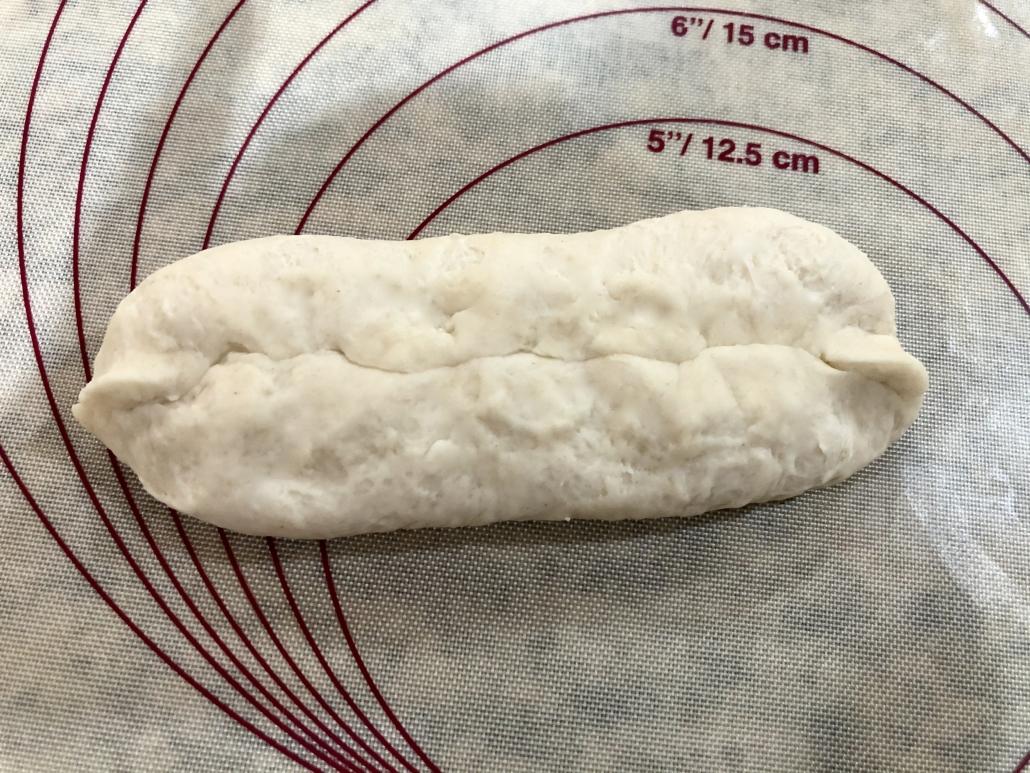 Closing the roll of the German Pretzel Buns Recipe